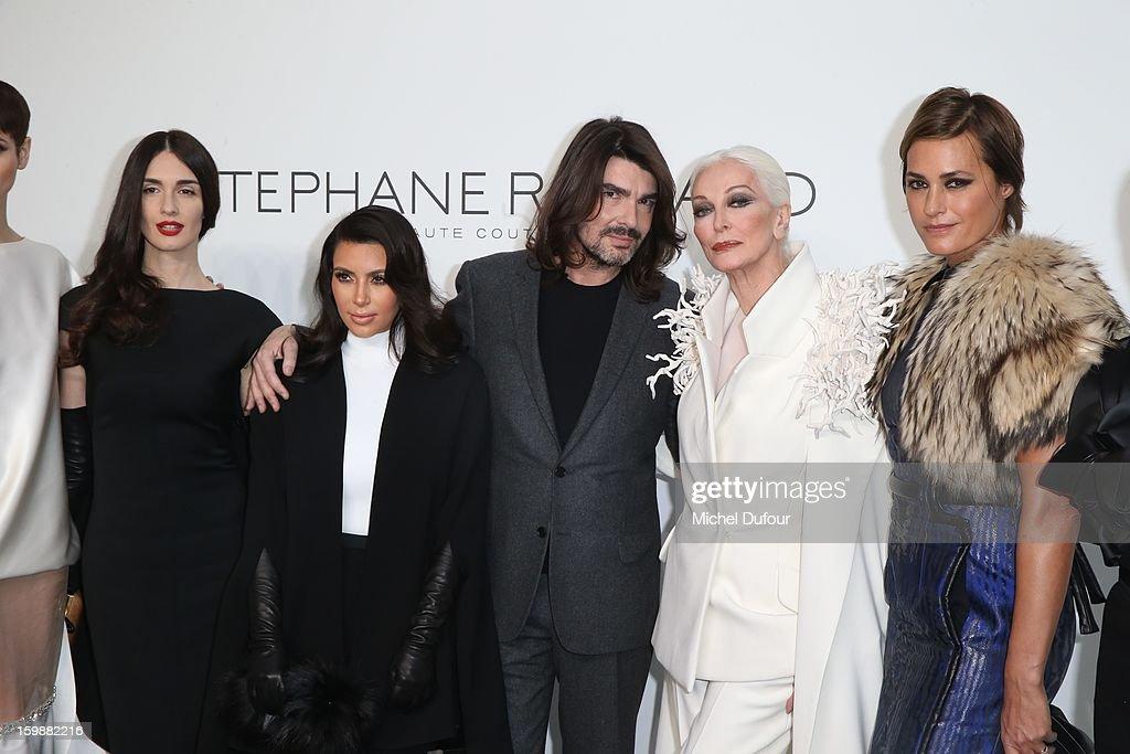 Paz Vega, Kim Kardashian, designer Stephane Rolland, Carmen Dell'Orefice and Yasmine LeBon attend the Stephane Rolland Spring/Summer 2013 Haute-Couture show as part of Paris Fashion Week at Palais De Tokyo on January 22, 2013 in Paris, France.