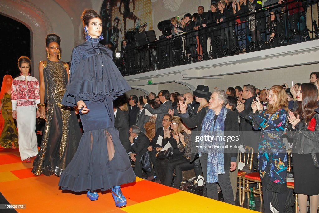 Paz Vega, Shanyn Leigh and Abel Ferrara watch models walking the runway during the Jean-Paul Gaultier Spring/Summer 2013 Haute-Couture show as part of Paris Fashion Week on January 23, 2013 in Paris, France.