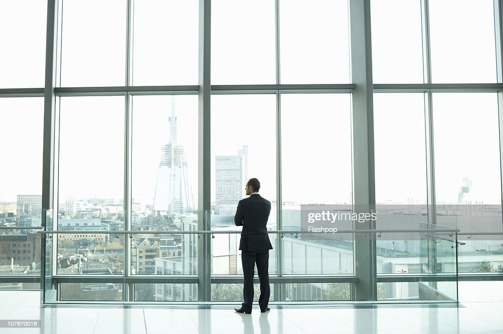 PBusinessman looking out across the city