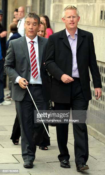 Pc David Rathband and friend Robin Palmer leave Newcastle Magistrates' Court after Kelsey Donkin from Southwick Sunderland admitted shouting 'bang...