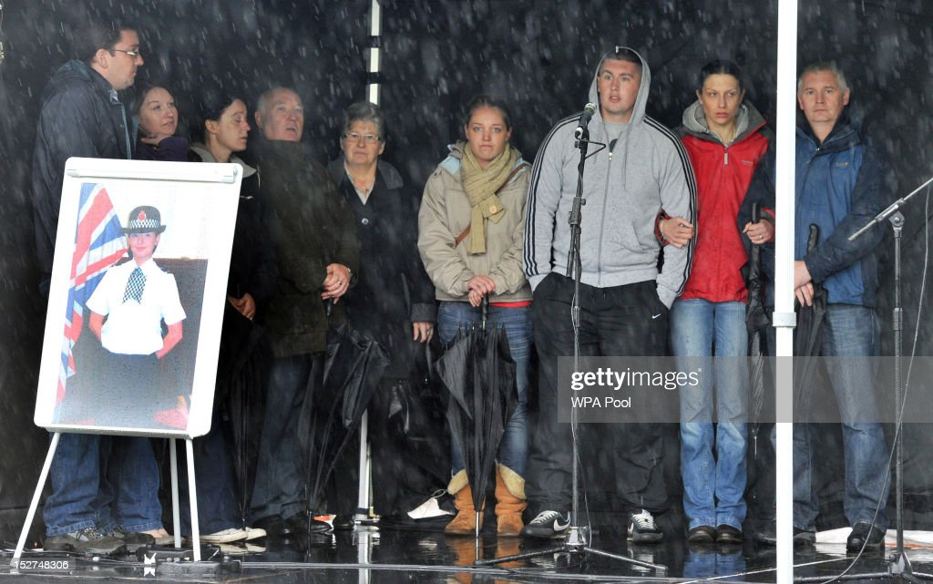 Pc Fiona Bone's parents Paul (4th L) and June (5th L), are joined by Pc Nicola Hughes' father Bryn (R) and step-mother Nat (2nd R) and other family members on stage during a vigil near Abbey Gardens, in Mottram on September 25, 2012 in Manchester, England. Members of the public joined police officers in a walk from Hyde police station to the scene of the killings, for a vigil of prayers and reflection. Dale Cregan, 29, appeared before Manchester Magistrates last week accused of four murders, including those of PC Nicola Hughes and PC Fiona Bone on September 18, and also in two separate attacks earlier this year on Mark Short and his father David Short. Cregan is also being charged with an additional four counts of attempted murder.