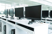 Computer Lab,Neatly placed rows of computer.