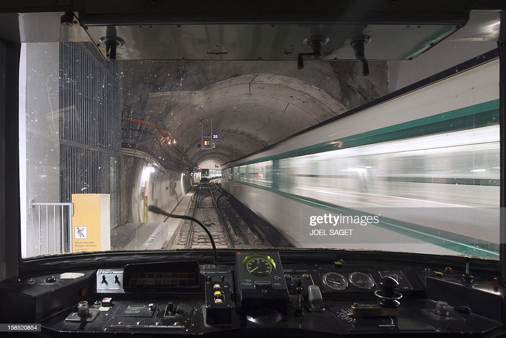 A pcture taken from the cockpit of a metro train shows a train driving through a tunnel on December 18, 2012 in Paris.