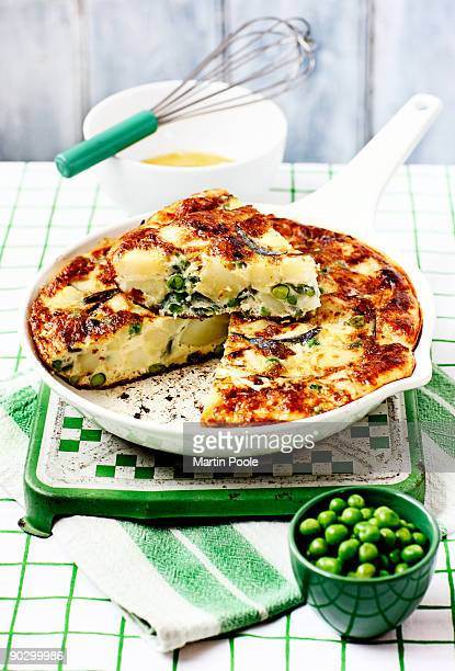 Pea and new potato frittata in dish