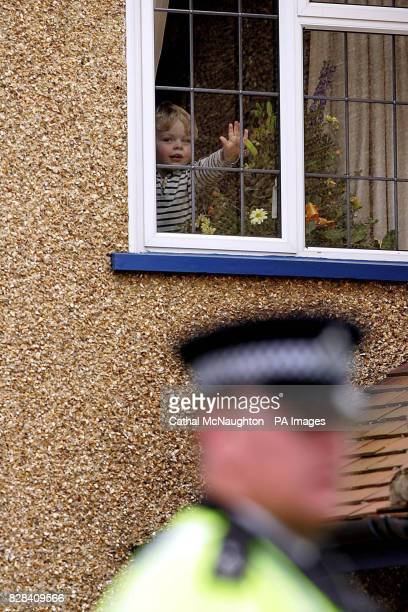 Peace activist Norman Kember's five old grandson Ben at the window as he arrives at his home in Pinner Middlesex Saturday March 25 2006 after being...