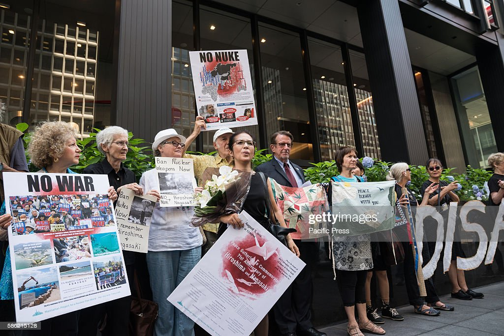 Peace activists hold banners and signs while standing on the sidewalk in front of the Consulate General of Japan in New York A coalition of antiwar...