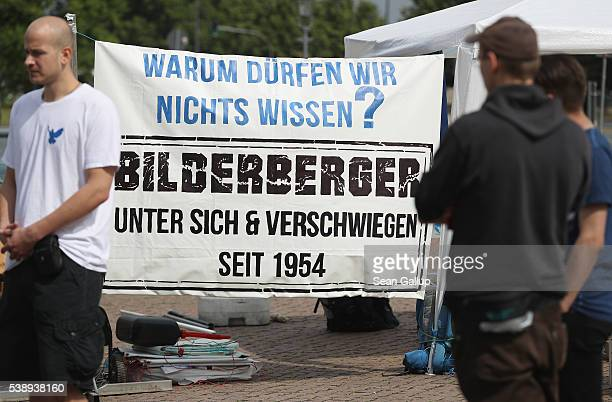 Peace activists with a banner that reads 'Why aren't we allowed to know Bilderberger amongst themselves and silent since 1954' maintain a vigil near...