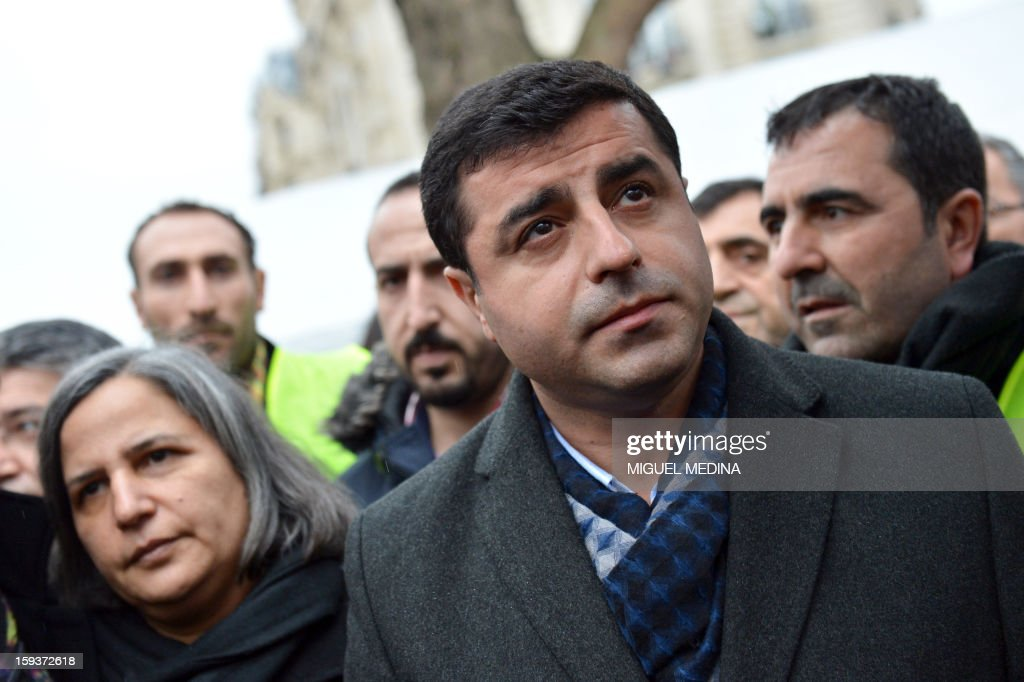Peace and Democracy Party (BDP) chairman Selahattin Demirtas (R) and co-chairman Gultan Kisanak (L) take part in a demonstration gathering hundreds of people of Kurdish origin on January 12, 2013 in Paris, two days after three Kurdish activits were found shot dead at Paris Kurdistan Information Bureau. Thousands of Kurds from all over Europe are gathered in Paris today for what is expected to be an angry protest over the killing of three female activists shot dead at least three times in the head, giving further credence to the theory of an execution-style hit. Kurdish activists have accused Turkey or rogue nationalist elements in the country's military of being behind the killings.