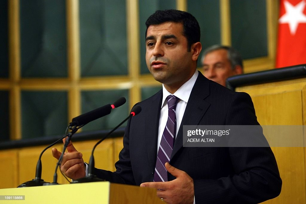 Peace and Democracy Party (BDP) co-chairman Selahattin Demirtas addresses members of parliament from his party and audience members during a meeting at the Turkish parliament in Ankara, on January 8, 2013.