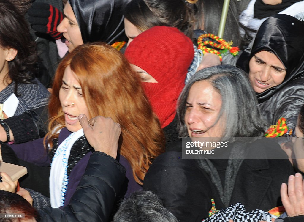 Peace and Democracy Party (BDP) Gulten Kisanak (R) cries upon the arrival of the coffins of the three top Kurdish activists, Sakine Cansiz, Fidan Dogan and Leyla Soylemez, shot dead in the French capital, on January 17 in Diyarbakir. Several thousand Kurds gathered Thursday in a square in Diyarbakir, the main city of Turkey's Kurd-majority southeast, to pay a final tribute to three Kurdish women activists who were assassinated in Paris last week. The growing crowd of participants, men and women adorned in white scarves, a symbol of peace, marched in a funeral many in Turkey feared would turn into a violent protest. The three women, one of them Sakine Cansiz, a co-founder of the outlawed Kurdistan Workers' Party (PKK), were found fatally shot, at least three times in their heads, at a Kurdish centre in Paris last week. French police were hunting the unknown assailants.