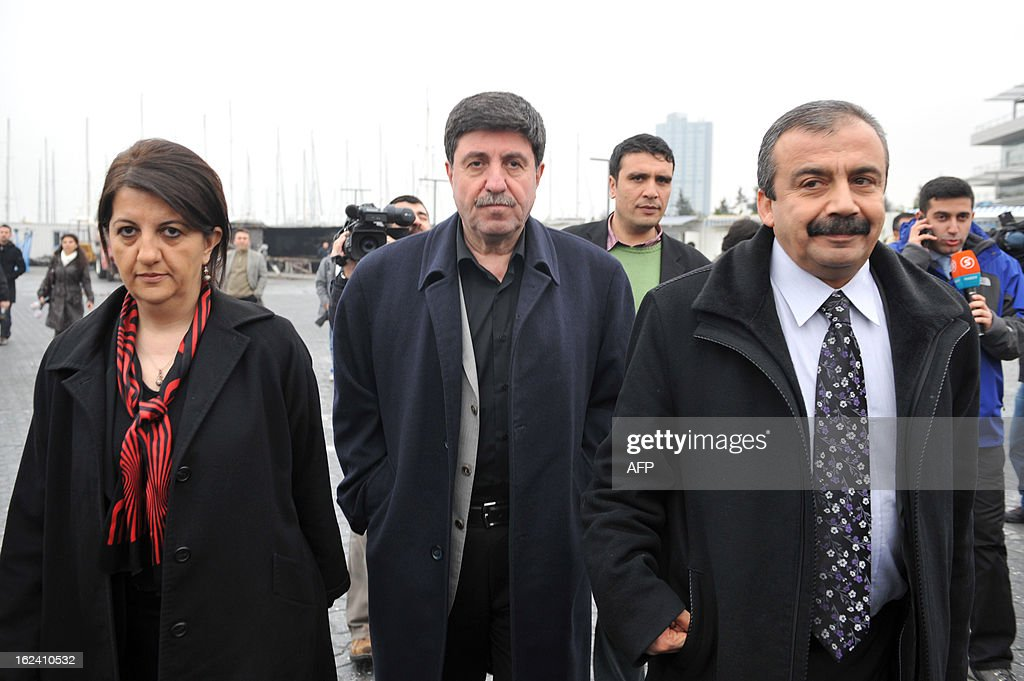 Peace and Democracy Party (BDP) members of the parliament Pervin Buldan (L), Altan Tan (C) and Sirri Sureyya Onder (R) are pictured prior to get on a boat to Imrali island in Istanbul, on February 23, 2013, prior to a meeting with jailed leader of PKK, Abdullah Ocalan, kept in prison on the island, as part of ongoing peace talks to disarm the PKK.
