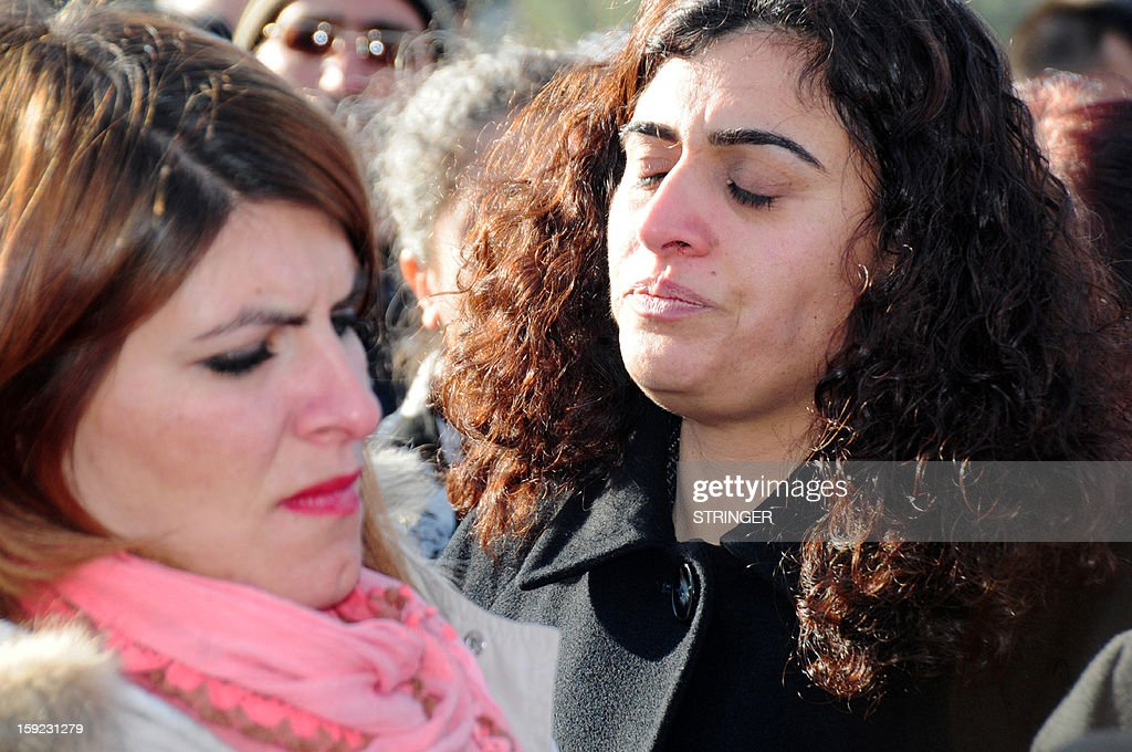 Peace and Democracy Party (BDP) Parliamentarian Sabahat Tuncel (R) mourns for the three Kurdish activists killed in Paris during a demonstration on January 10, 2013, in Diyarbakir. Sakine Cansiz, Fidan Dogan, and Leyla Soylemez members of the outlawed Kurdistan Worker's Party (PKK) have been shot dead on January 9, 2013 in Paris in what France's interior minister dubbed an 'assassination'. The women were found in the early hours with gunshot wounds to the head inside a Kurdish information centre in the 10th district of the French capital, police and the centre's director said. French Interior Minister Manuel Valls visited the scene of the crime and described the killings as 'assassinations'. The murders came after Turkish media reported on January 9 that the Turkish government and jailed Kurd rebel leader Abdullah Ocalan had agreed on a roadmap to end a three-decade-old insurgency that has claimed tens of thousands of lives.