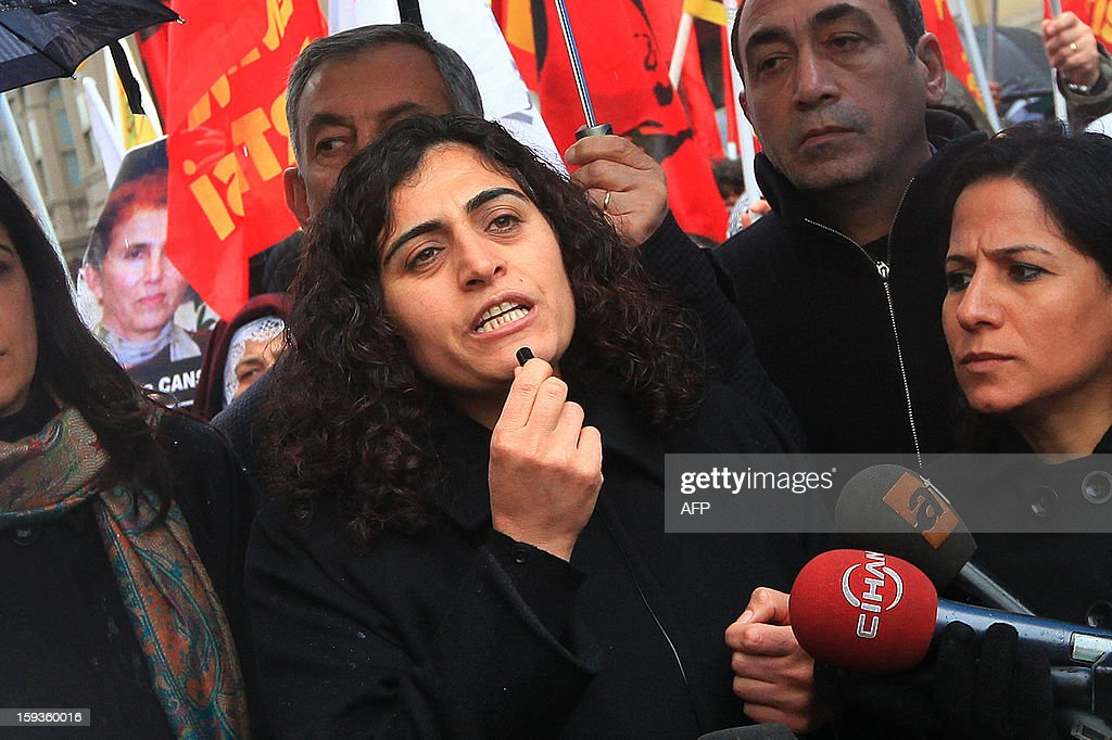 Peace and Democracy Party (BDP) Parliamentarian Sabahat Tuncel (C) speaks during a rally in front of the French Consulate in Istanbul on January 11, 2013. Demonstrators gathered at the French Consulate in Istanbul following the killings of three Kurdish women activists on 10 January, including Sakine Cansiz, a founding member of the militant Kurdistan Workers Party (PKK). Cansiz, who had been living in exile in France for years, was found dead in the early hours of 10 January in a Kurdish documentation centre on the first floor of an apartment building near Gare du Nord train station. Two other women - the president of the centre, Fidan Dogan, and Leyla Soylemez, also described as an activist - were also killed. AFP PHOTO/MIRA