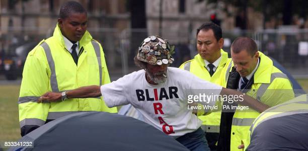 Peace campaigner Brian Haw with council officials after letters were issued to campers asking them to leave Parliament Square after claims that they...