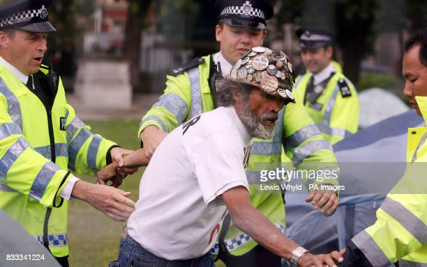 Peace campaigner Brian Haw with police after letters were issued to campers asking them to leave Parliament Square after claims that they have...