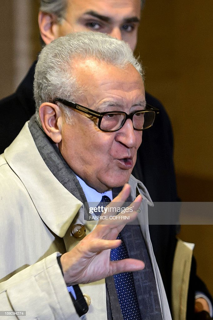 UN peace envoy Lakhdar Brahimi (C) waves upon his arrival on January 11, 2013 for a meeting at the United Nations office in Geneva. Brahimi is to meet with Russian Deputy Foreign Minister Mikhail Bogdanov and US Undersecretary of State William Burns for discuss ways of ending the 21-month conflict in Syria.