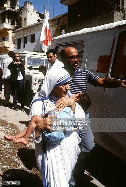 Peace Nobel Prize Mother Teresa hugs a child in West Beirut on August 14 1982 Mother Teresa visited the children who were in the Islamic Home which...