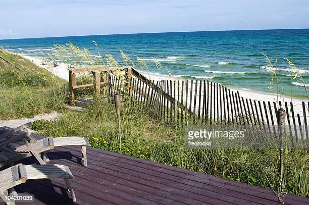 A peaceful beach with a white sand
