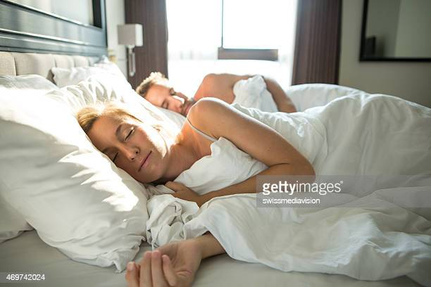 Peaceful couple sleeping in the morning