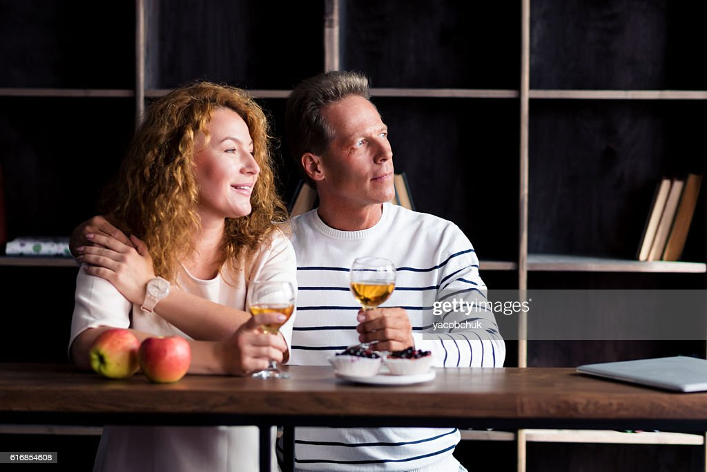 Peaceful grandparents resting at home : Stock Photo