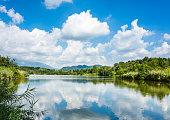 peaceful Italian lake under a sky full of clouds