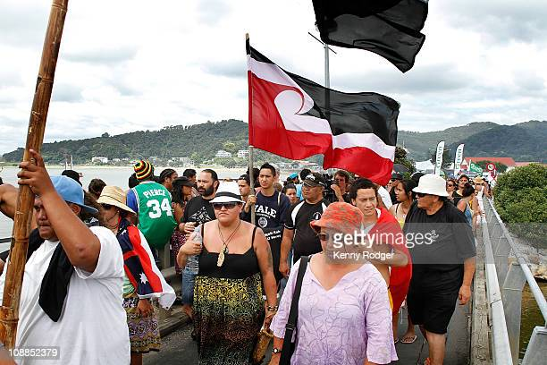 A peaceful protest group march over a bridge during the Waitangi Day celebrations on February 6 2011 at Waitangi Northland New Zealand Waitangi Day...