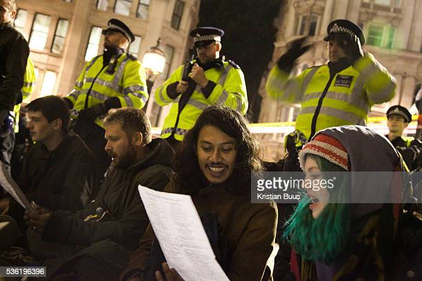 Peaceful singing in front of police linesThe London Stock Exchange was attempted occypied in solidarity with Occupy Wall in Street in New York and in...