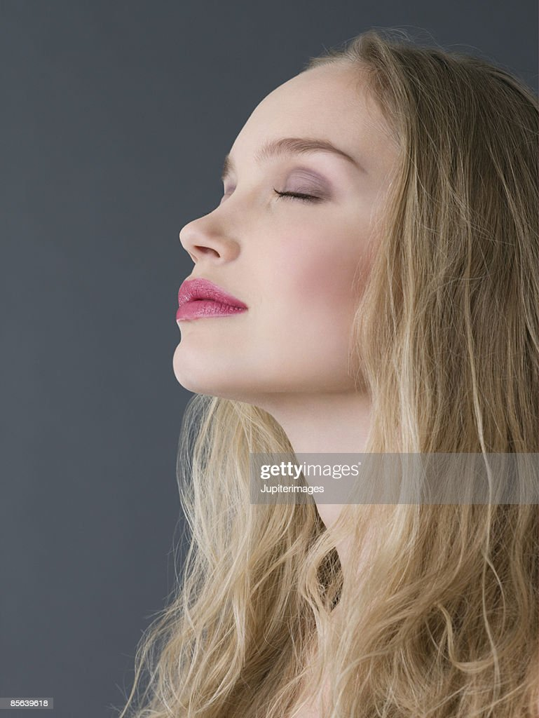 Peaceful woman with eyes closed : Stock Photo