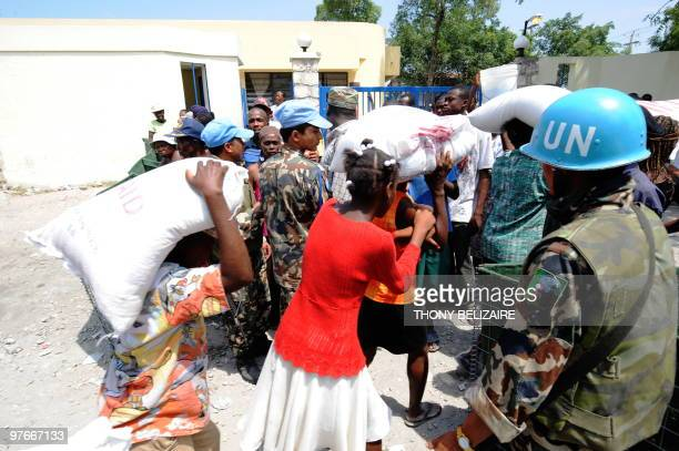 A UN peacekeeper guards a food distribution point in PortauPrince on March 12 2010 Two months after Haiti's January 12 earthquake aids groups were...