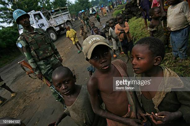 Peacekeepers from India patrol a camp for people displaced by milita violence July 26 2007 in Rutshuru Eastern Congo Over 1500 families live in the...