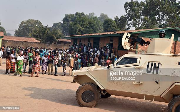 UN peacekeepers patrols ouside the polling station in Bangui on December 30 as people go to the polls to take part in the country's presidential and...