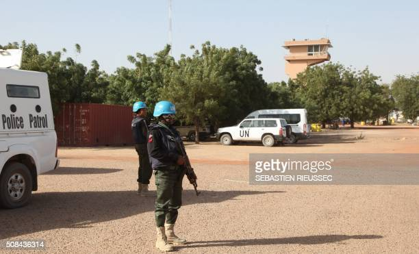 UN peacekeepers stand guard near the airport on February 4 2016 in Timbuktu central Mali Mali's fabled city of Timbuktu on February 4 celebrated the...