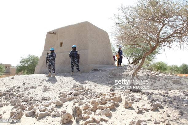UN peacekeepers stand next to the mausoleum of Alpha Moya on February 4 2016 in Timbuktu Mali's fabled city of Timbuktu on February 4 celebrated the...