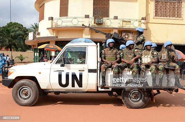 UN peacekeeping soldiers from Rwanda patrol on December 09 2014 in Bangui The UN peacekeeping mission currently counts 8600 people on the ground and...