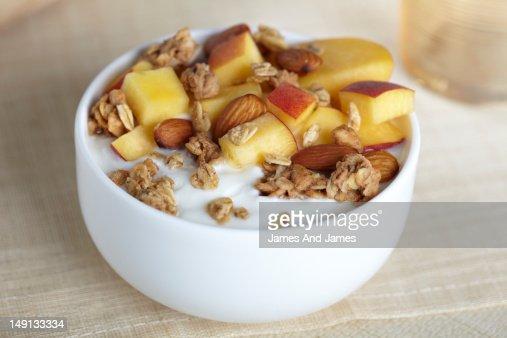 Peach and Granola on Yogurt : Stock Photo