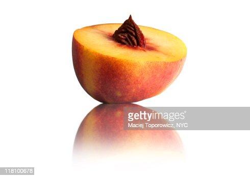 Peach on reflective surface : Stock Photo