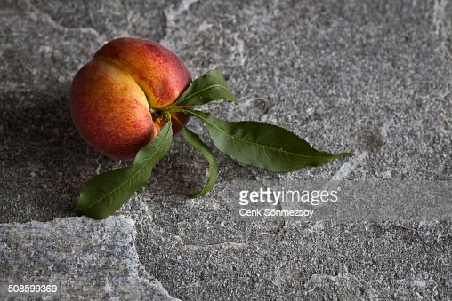 Peach with leaves : Stock Photo