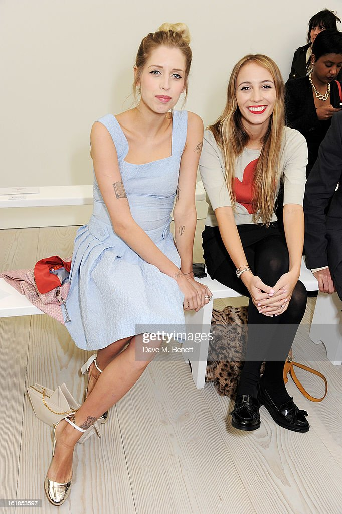 Peaches Geldof (L) and Harley Viera-Newton attend the Vivienne Westwood Red Label show during London Fashion Week Fall/Winter 2013/14 at the Saatchi Gallery on February 17, 2013 in London, England.