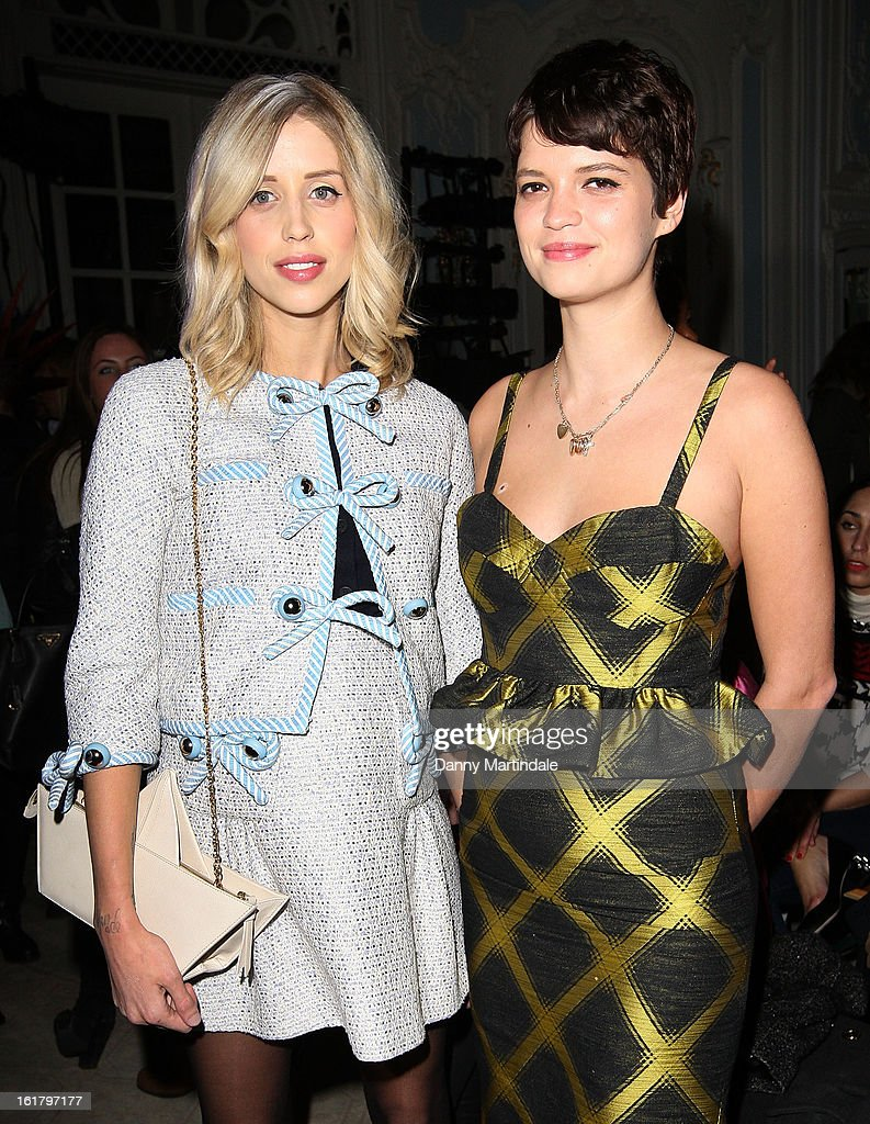 Peaches Geldof and Pixie Geldof (R) attend the Moschino cheap&chic show during London Fashion Week Fall/Winter 2013/14 at The Savoy Hotel on February 16, 2013 in London, England.