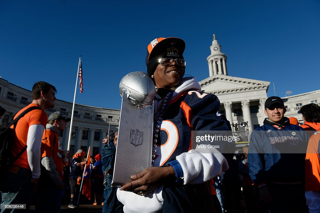 Peaches Hall holds a homemade version of the Lombardi Trophy at Civic Center Park before the Denver Broncos Super Bowl 50 celebration parade February 07, 2016.