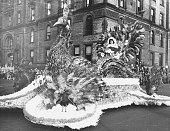 A peacock float taking part in a Thanksgiving Day Parade in a US city