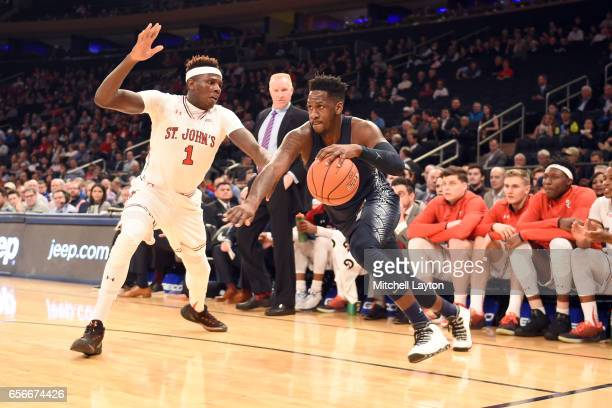 J Peak of the Georgetown Hoyas dribbles by Bashir Ahmed of the St John's Red Storm during the Big East Basketball Tournament First Round game at...