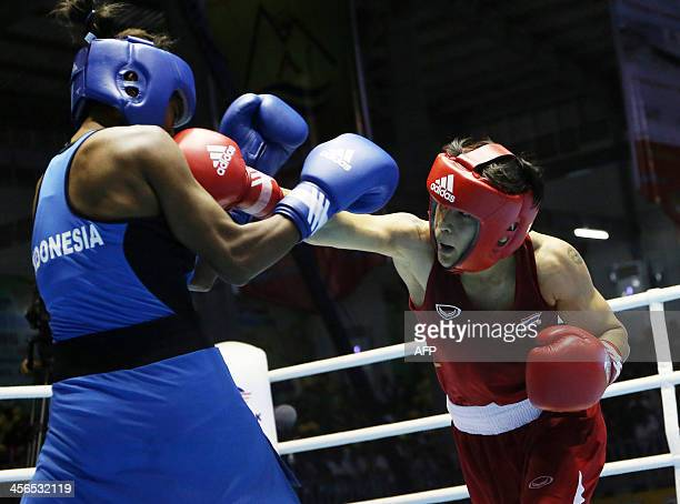 Peamwilai Laopeam of Thailand fights with Ester Kalayukw of Indonesia during the women's 54kg Final at the Wunna Theikdi Boxing Centre during the...