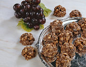a tray of peanut and raisin clusters