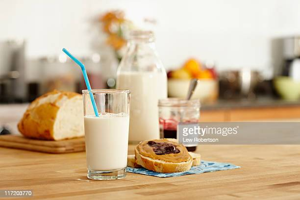 Peanut butter and jelly sandwhich with milk