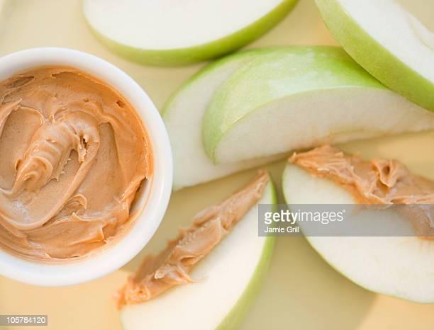 Peanut butter on sliced apple
