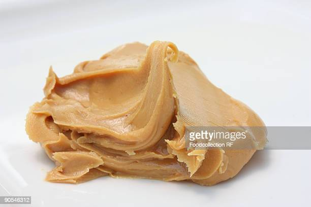 Peanut butter on white background, close up