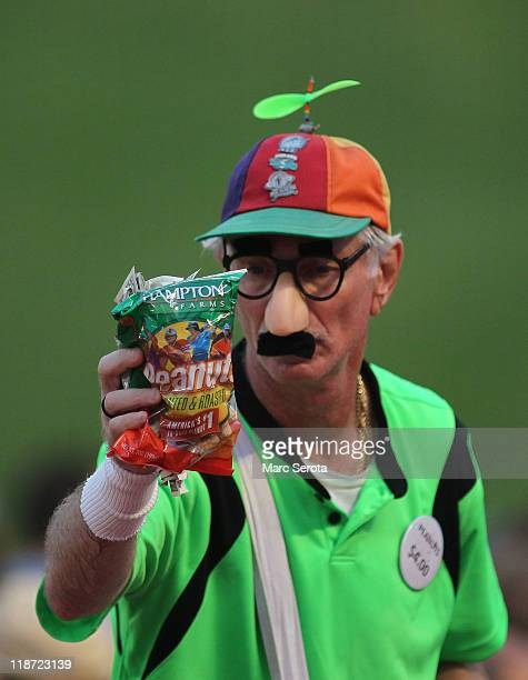 A peanut vendor works as the Philadelphia Phillies play against the Florida Marlins at SunLife Stadium on July 6 2011 in Miami Gardens Florida