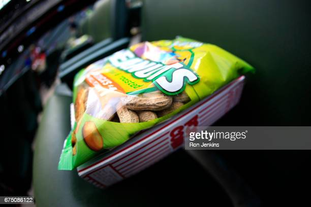 Peanuts and popcorn are placed in field level seats before the Rangers play the Los Angeles Angels of Anaheim at Globe Life Park in Arlington on...