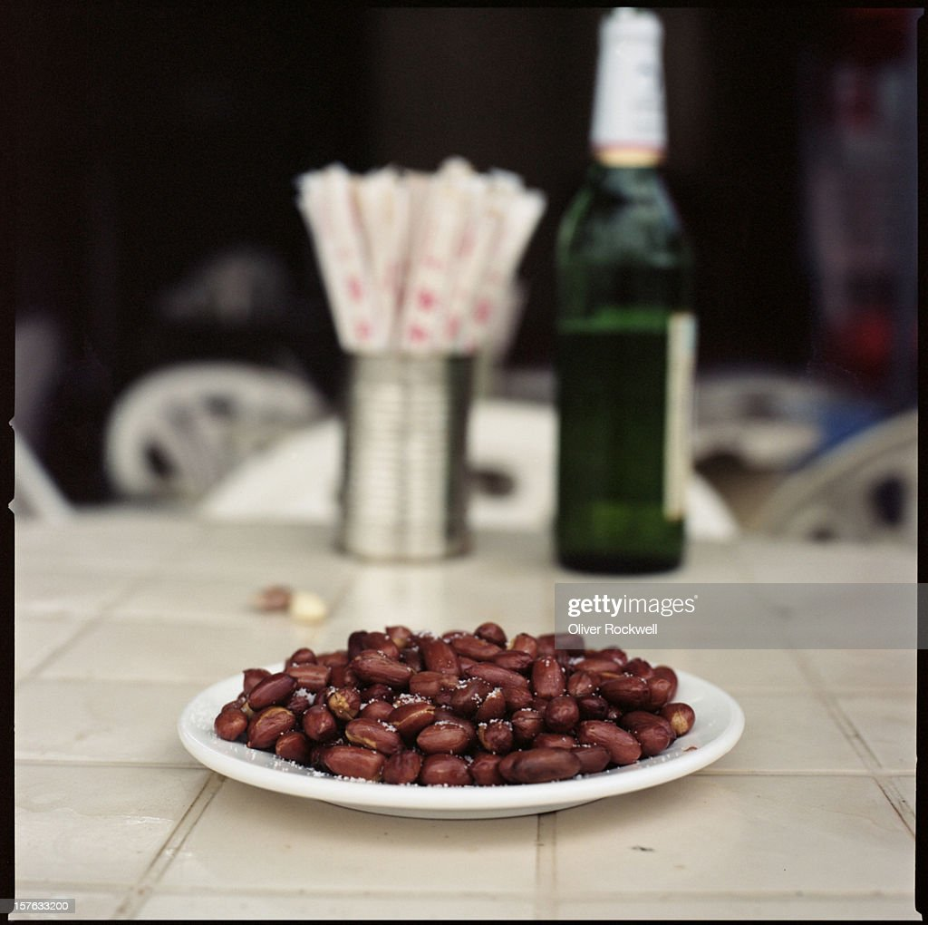 peanuts, chopsticks and beer : Stock Photo